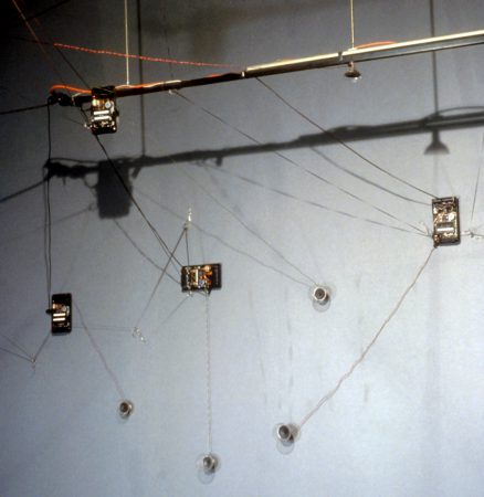 MAGNETIC STREAMS - Seven deconstructed tape recorders are placed around the room with three continuous tape loops playing between them. Tapes are played backwards and forwards to create a rhythmic cacophony of magnetic streams.