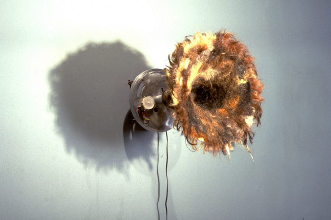 "DIGITAL SCAT (15"" x 12"" x 15"") - Randomly samples conversations and scats them back. This sculpture is covered in human hair, uses three sound sampling chips and a timer."